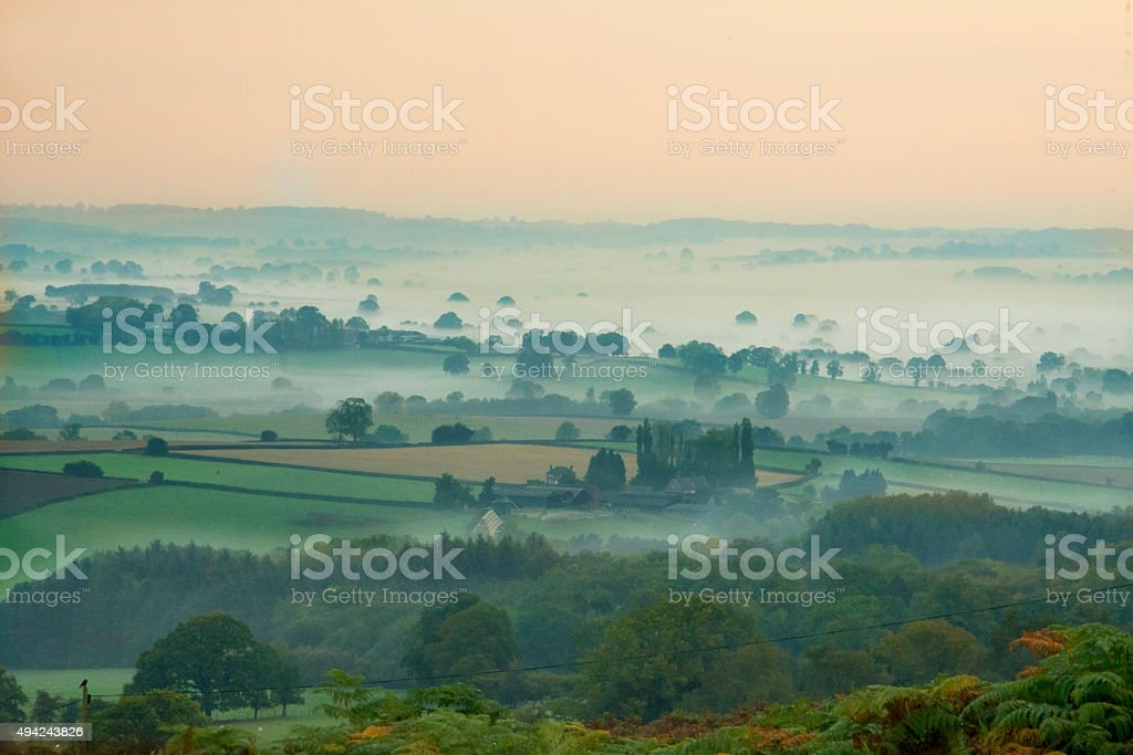 clouds and fog landscape stock photo