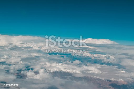 Clouds and mountains. Airplane view.
