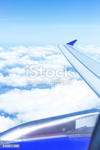 istock Clouds and sky as seen through window an aircraft 546801366