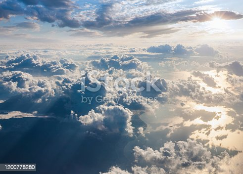 497491241 istock photo Clouds and sky as seen through window of an aircraft 1200778280
