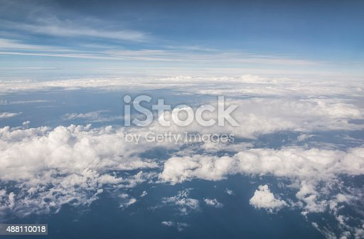 istock Clouds and sky as seen through window of an aircraft 488110018