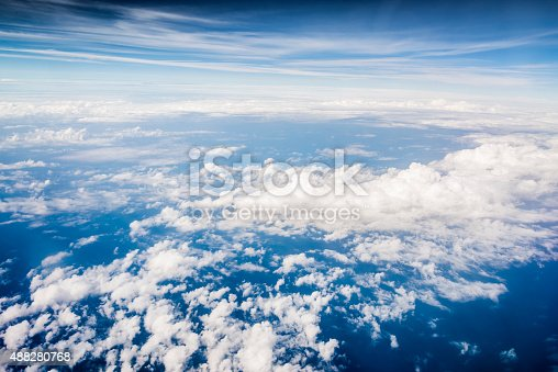 istock Clouds and sky as seen through window of an aircraft 488280768