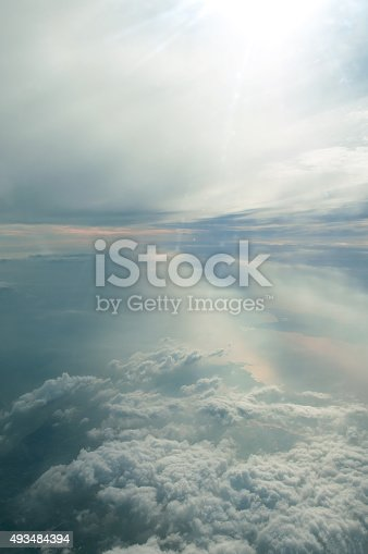 istock Clouds and sky as seen through window of an aircraft 493484394