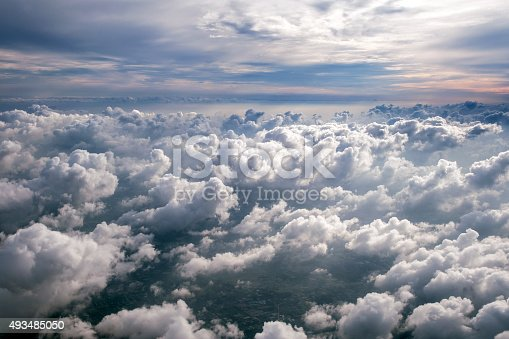 497491241 istock photo Clouds and sky as seen through window of an aircraft 493485050