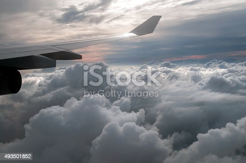 istock Clouds and sky as seen through window of an aircraft 493501852