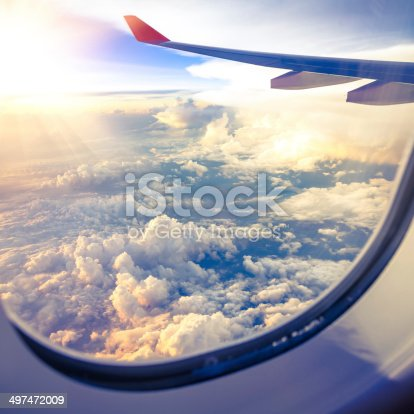 istock Clouds and sky as seen through window of an aircraft 497472009