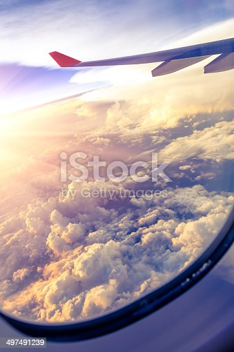 497491241 istock photo Clouds and sky as seen through window of an aircraft 497491239