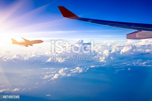497491241 istock photo Clouds and sky as seen through window of an aircraft 497491245