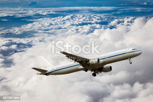istock Clouds and sky as seen through window of an aircraft 497567893