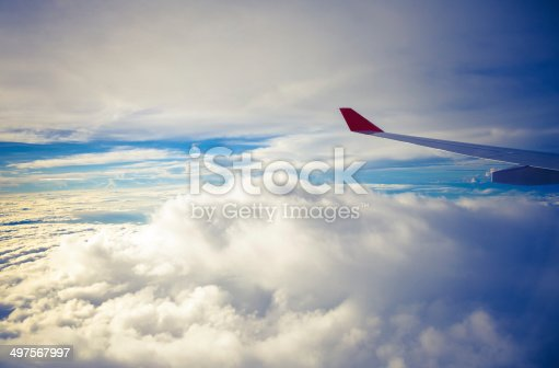 istock Clouds and sky as seen through window of an aircraft 497567997