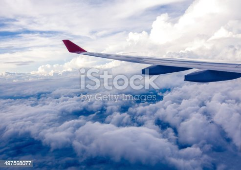 istock Clouds and sky as seen through window of an aircraft 497568077