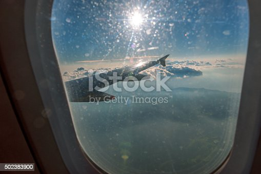 istock Clouds and sky as seen through window of an aircraft 502383900