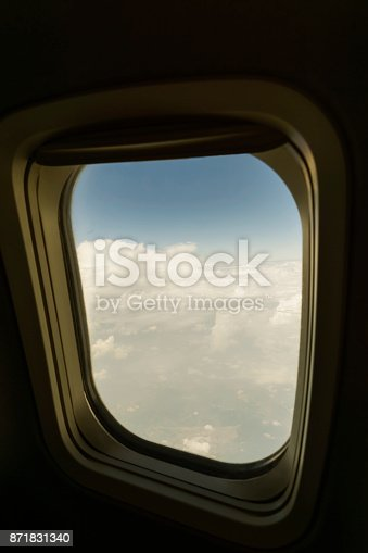 istock Clouds and Sky as Seen Through Window of an Aircraft 871831340