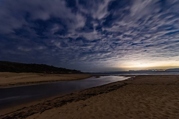 Clouds and Stars Nightscape at the Beach stock photo