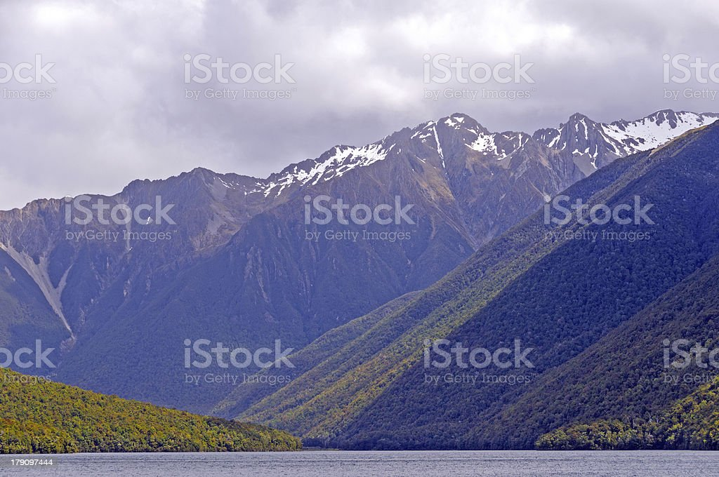 Clouds and Sun in the Mountains stock photo