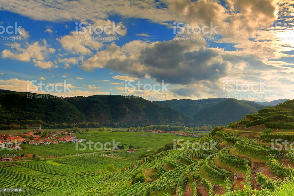 Clouds and sun over valley stock photo