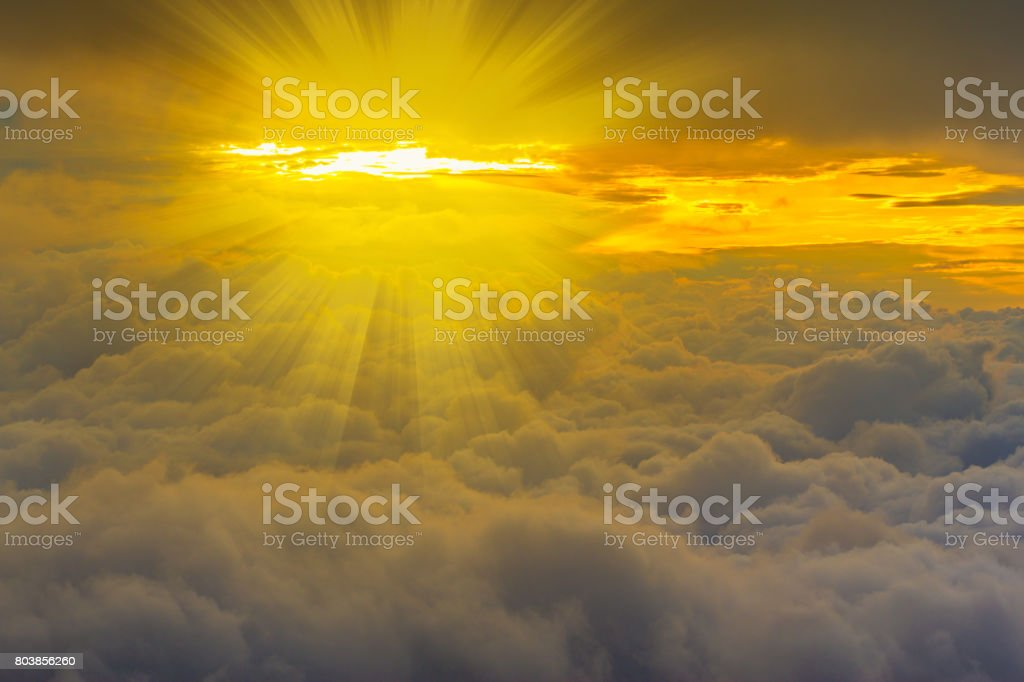 clouds and yellow light beams stock photo