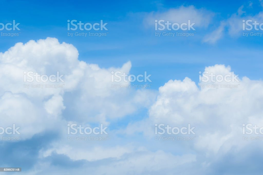 Clouds are divided into layers in the evening with light. stock photo
