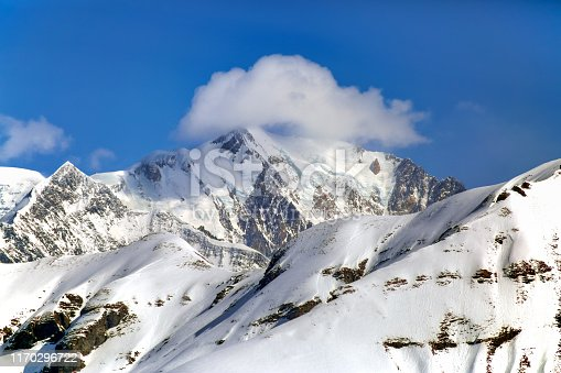 Clouds around the peak of Mont Blanc at French Alps on a sunny day (View from Rochebrune).