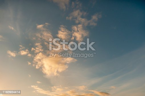 sun illuminating the yellow color of the clouds