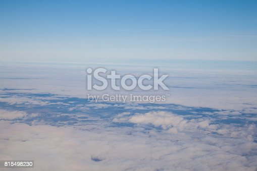 1045890176 istock photo clouds at sunset from the plane in the sky landscape 815498230