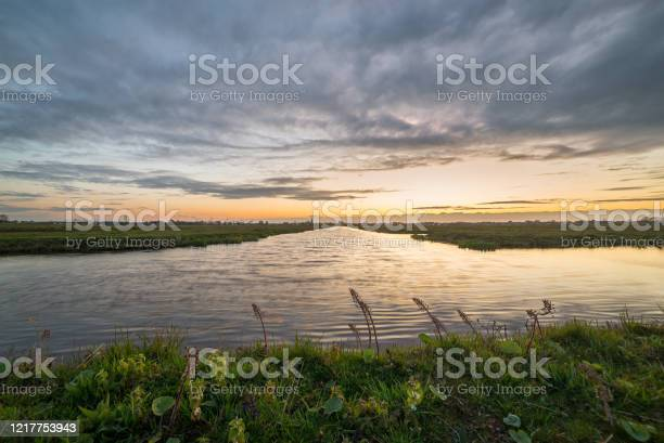 Photo of Clouds at sunset over the dutch polder landscape near Gouda, Holland