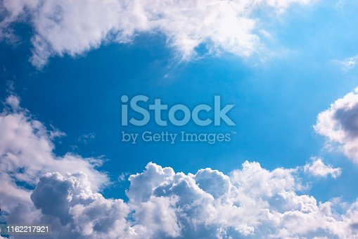 White clouds over blue sky with copy space