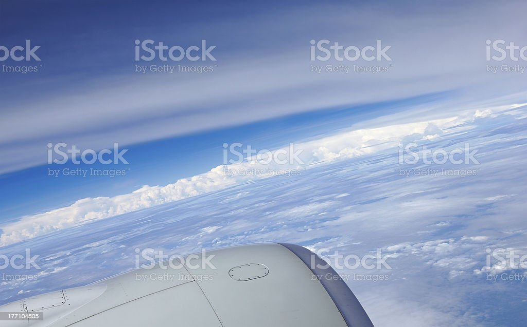 Clouds blue sky and reaction turbine - view from airliner stock photo