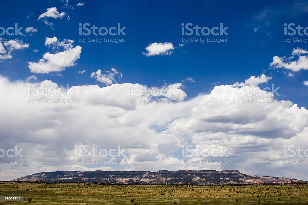 Clouds Build Over Desert Plain royalty-free stock photo