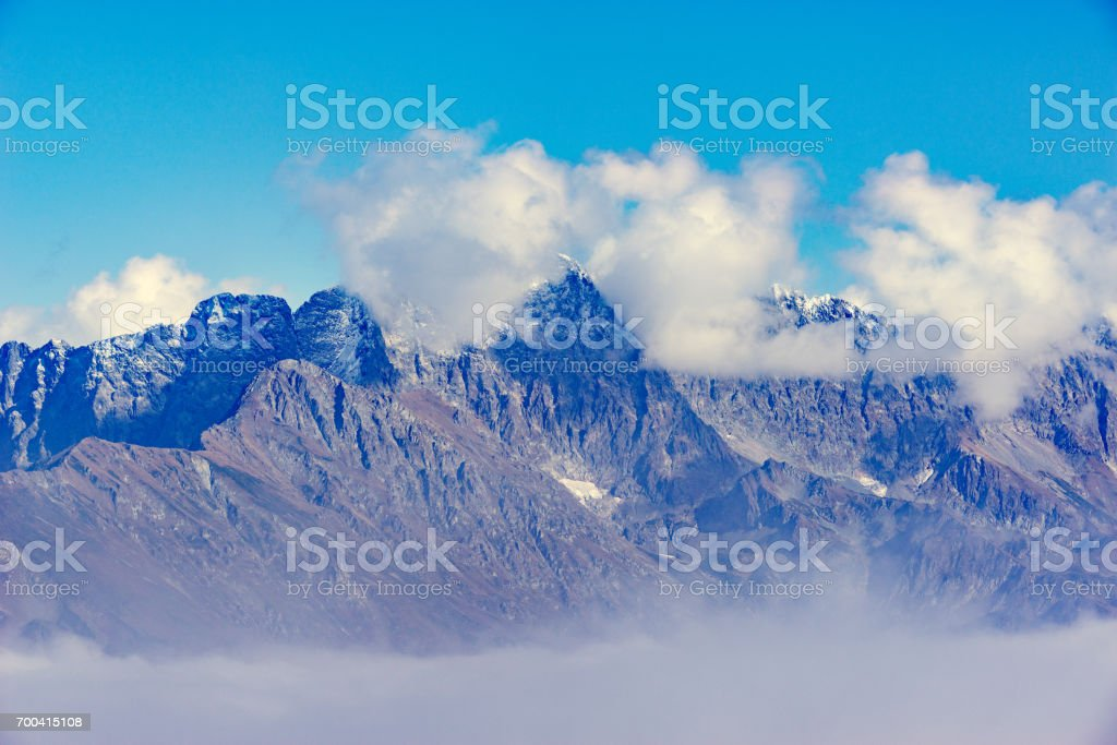 Clouds cover the mountain tops. stock photo