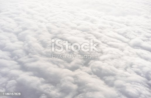 An aerial view of a thick layer of clouds, photographed from an airplane.