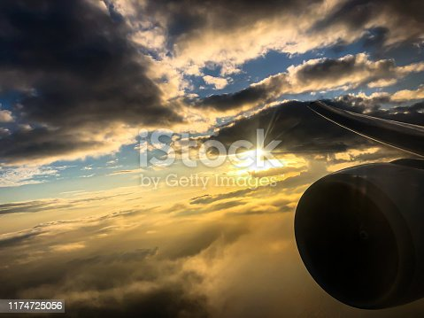 902818356 istock photo clouds from airplane wing 1174725056