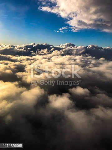 184857129istockphoto clouds from airplane wing 1174725065