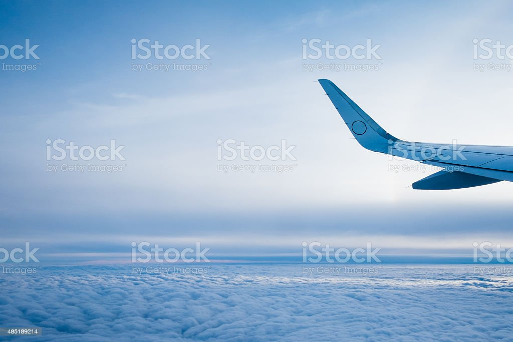 Clouds from commercial jet stock photo