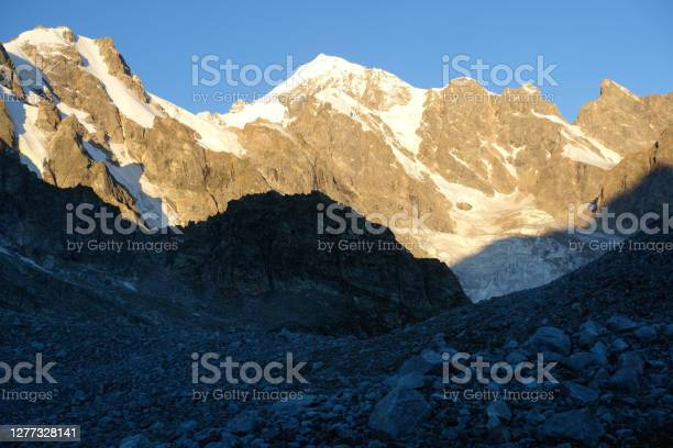 Photo of Clouds in a mountain valley. Dawn in the mountains.