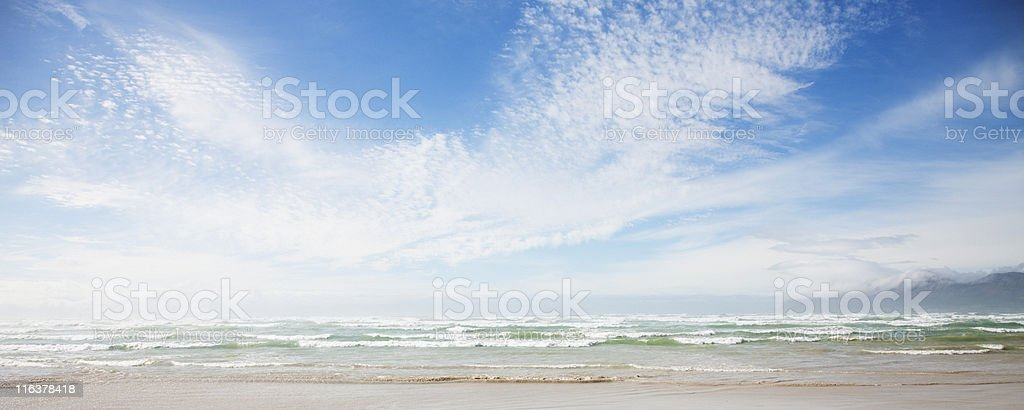 Clouds in blue sky over ocean stock photo