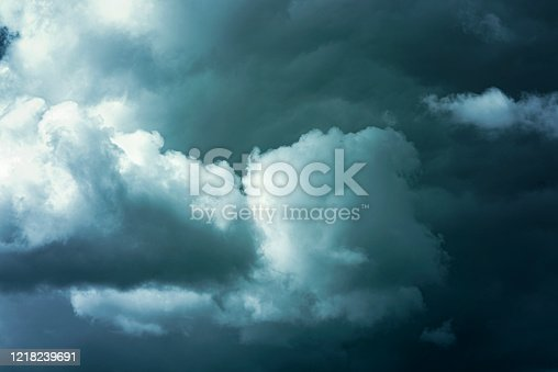 858837068 istock photo Clouds in dark sky before heavy storm 1218239691