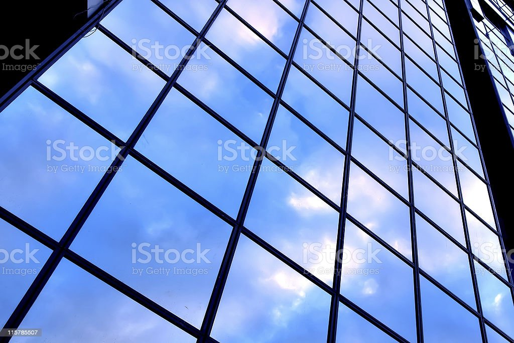 clouds in glazed panel skyscraper royalty-free stock photo