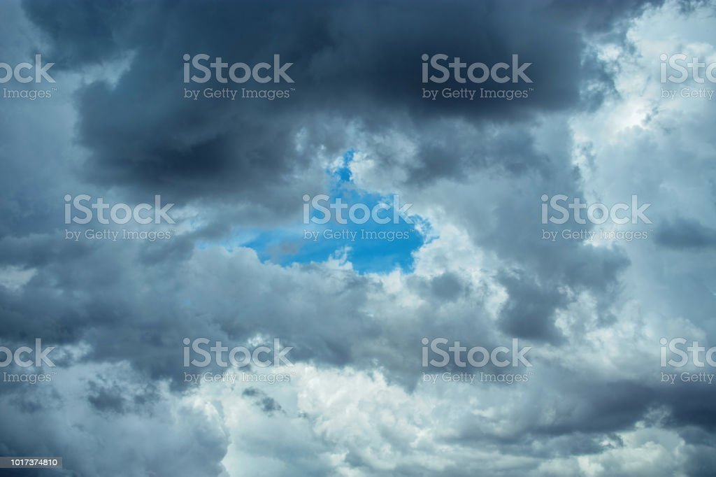 clouds in sky with blue in center stock photo