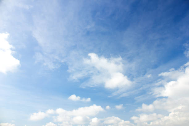 clouds in the blue sky background - skies stock photos and pictures