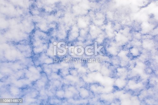 istock Clouds in the blue sky 1056148572