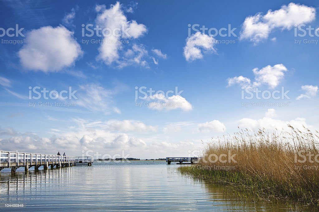 Clouds, jetty and reed  Altocumulus Stock Photo