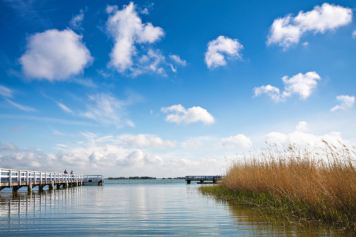 Clouds Jetty And Reed Stock Photo - Download Image Now