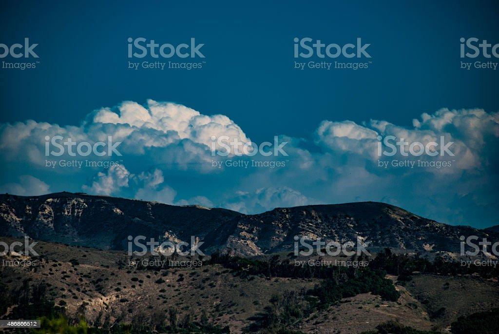 Clouds nestled against Saddleback Mountains stock photo