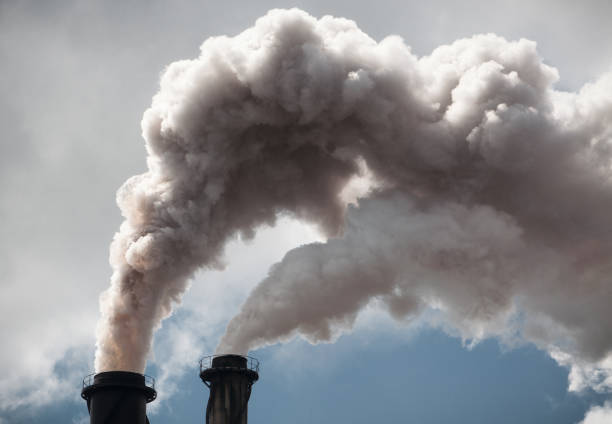 clouds of smoke from industrial chimneys - anidride carbonica foto e immagini stock