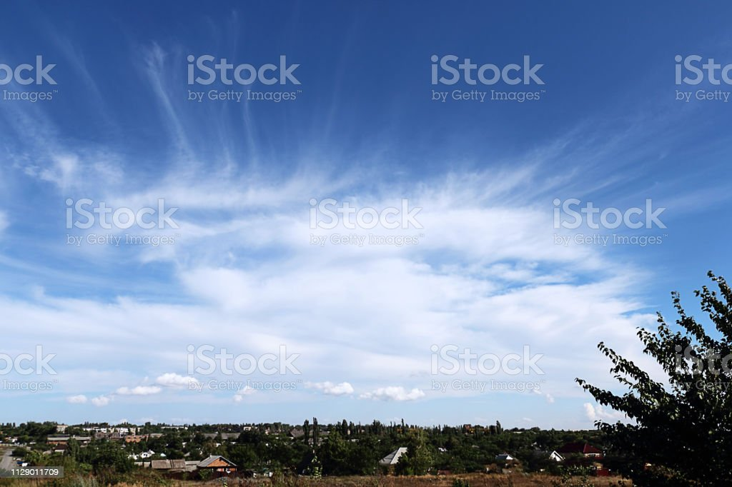 Clouds on a bright blue sky. Colorful landscape, field, sunny...