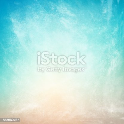 istock clouds on a textured vintage paper background 535560767