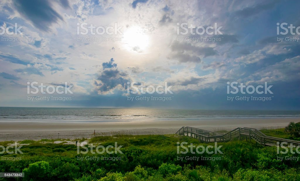 Clouds on Lush Beach stock photo