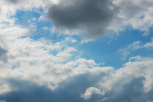 Clouds on the blue shiny sky stock photo