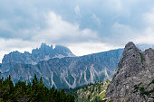 beautiful clouds on the peaks of the Dolomites UNESCO heritage near Cortina on a strange summer day
